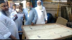 DISTRIBUTION OF SEWING MACHINES, HANDCARTS & TRICYCLES FOR THE DISABLED
